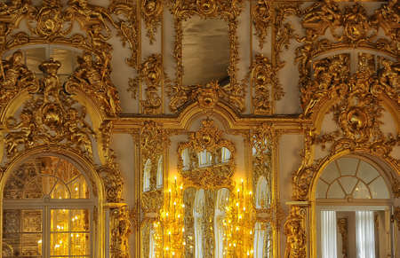 Gold stucco on the walls of the palace. Editorial