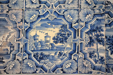tiled stove: Blue white paintings on a tiled stove