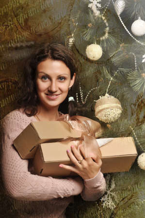 woman with a gift in their hands photo
