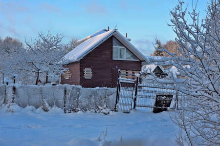 beautiful winter landscape with snow-covered home\