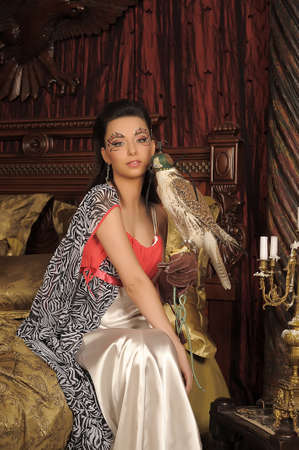 Young beautiful woman with falcon  photo