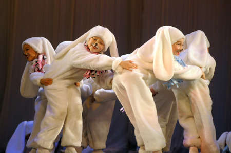children dancing in bunny costumes