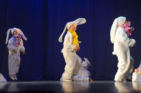 children dancing in bunny costumes
