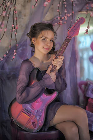 chatoyant: Beautiful young girl with electric guitar