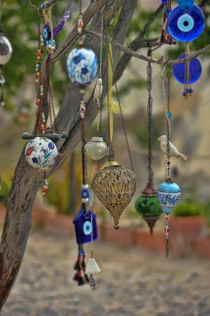 mementos: Evil eye charms hang from a bare tree in Cappadocia, Turkey.