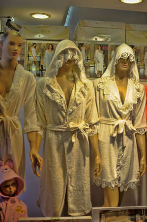 house robe: Home releted products in a shop: bath robes, pillows and curtains, Kemer, Turkey.