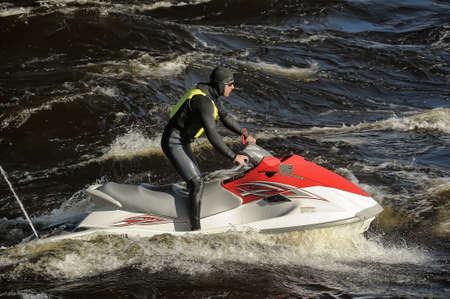 jetski: Dives Man on jet-ski Editorial