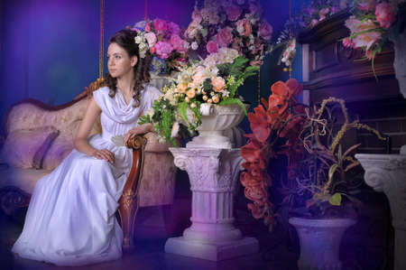 among: Exquisite elegant girl in white dress among the flowers.