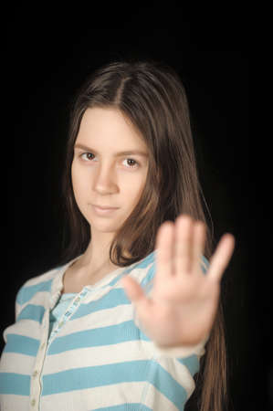 Girl making stop gesture with her hand. photo