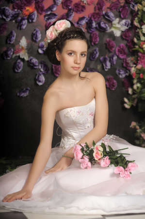 Young bride with flowers in her hair on a floral background Stock Photo - 30408589