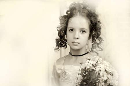 Beautiful portrait of a girl in Victorian era retro style, sepia. photo