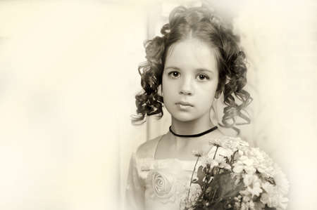 edwardian: Beautiful portrait of a girl in Victorian era retro style, sepia.