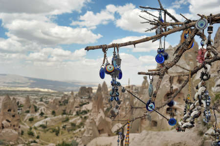 curios: Evil eye charms hang from a bare tree in Cappadocia, Turkey.