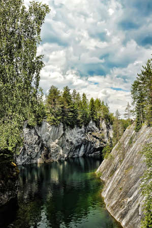 A photo of the flooded marble quarry at Ruskeala, Russia  photo