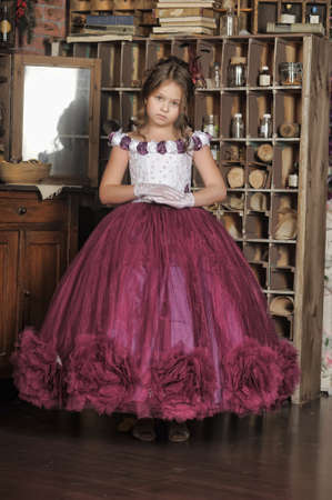 Vintage portrait of little girl in purple dress photo