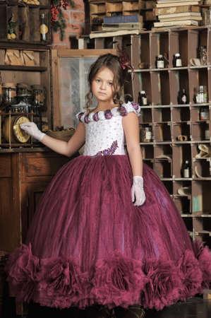 Vintage portrait of little girl in purple dress photo