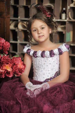 jaunty: Vintage portrait of little girl in purple dress