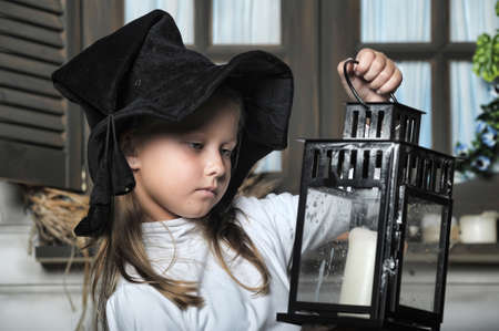 Girl with lanterns in witch hat photo