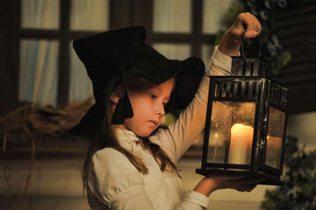 enjoymant: Girl with lanterns in witch hat