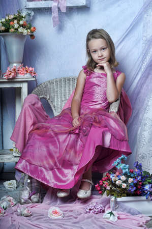 Girl in a pink dress photo