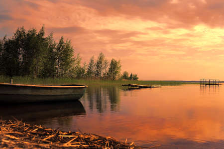 beautiful sunset on the lake in summer photo