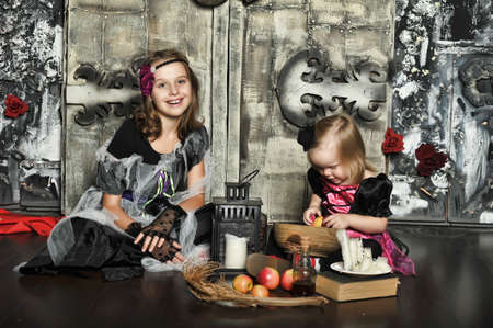 Two young witch conjure together