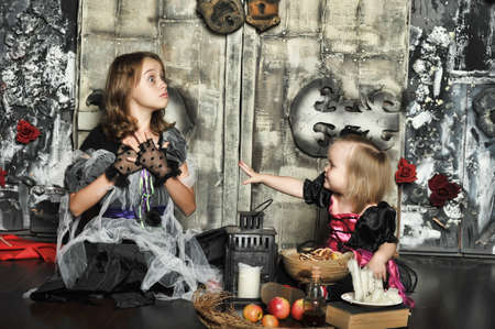 bewitchment: Two young witch conjure together