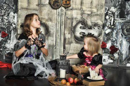 Two young witch conjure together photo
