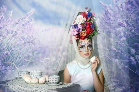 Girl with flowers on her head during a tea party photo