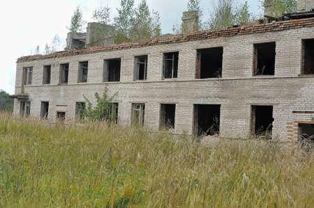 barracks: Abandoned brick two-story building - military barracks, Russia.
