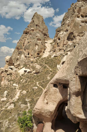 N ancient times people carved out homes in the fairy chimney rock formations in Cappadocia, Turkey. The houses are a popular tourist attraction for people on vacation or holiday. photo