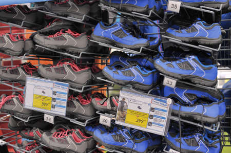Racks with Sneakers at the sports store Decathlon, Russia.