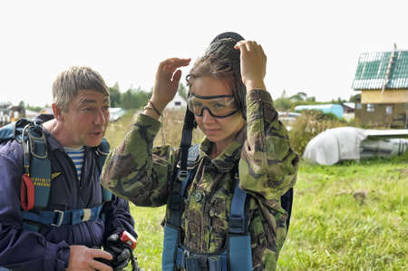 adrenaline rush: Instructions before skydiving in tandem, aviaklub Pinery, Russia. Editorial