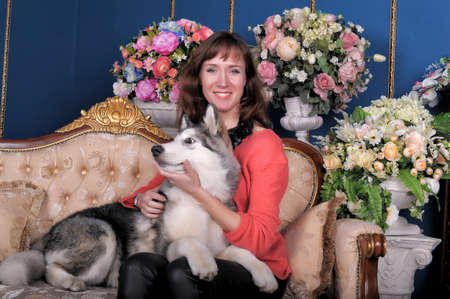 Woman with a puppy Malamute 6 months. photo