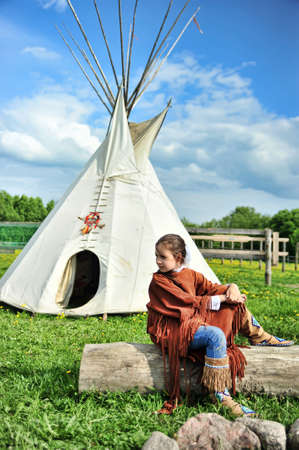 American Indian girl on a background of the tent photo