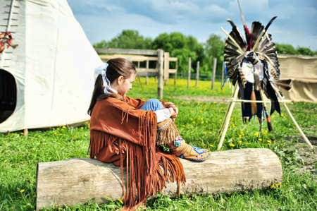 swarty: American Indian girl on a background of the tent