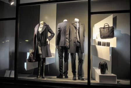 show cases: Mannequins in black clothes in a shop window, Tallinn, Estonia