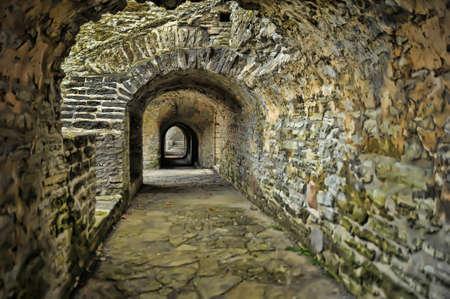 Stone corridor of a medieval castle. photo