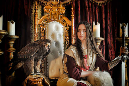queen's theatre: Warrior Princess on the throne with an eagle sitting.