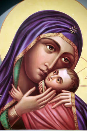 The Icon a Mother of God (Mary) and child (Jesus Christ) on gilding wood. Stock Photo