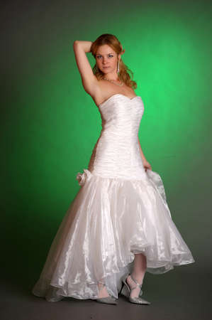 girl wedding dress on a green background in the studio photo