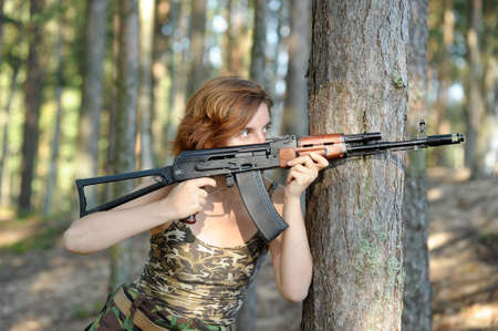 Portrait of a girl with the AKS-74 photo
