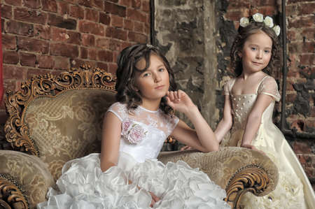 antique chair: Two girls in white dresses and antique chair.