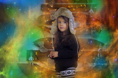 esquimales: La ni�a en una gorra con orejeras. Foto de archivo