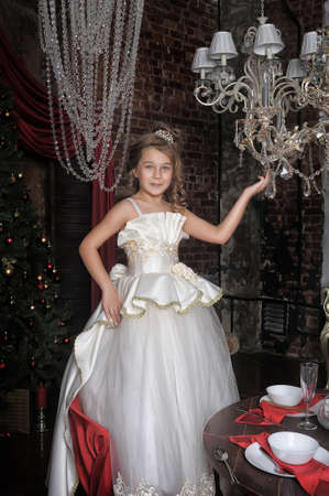 Young girl and the chandelier. Stock Photo