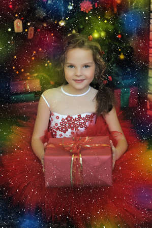 girl in a red dress with a gift in hands photo