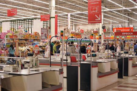Cash zone in the supermarket Auchan, St. Petersburg, Russia.