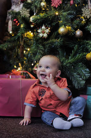 pineal: little boy at the Christmas tree with gifts