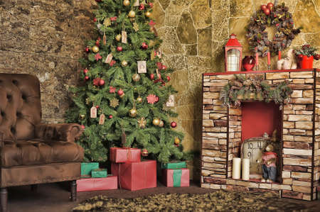 Interior room with fireplace, chair and Christmas tree photo