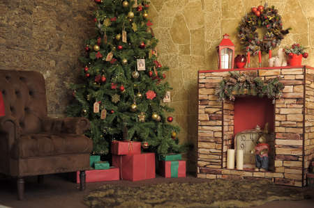 Interior room with fireplace, chair and Christmas tree